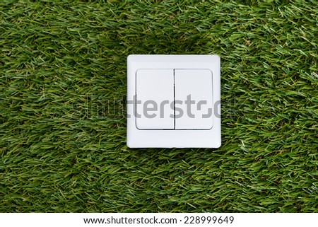 Directly above shot of switch on grass - stock photo
