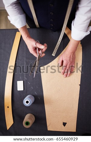 Directly above shot of tailor  working in atelier studio, making business suit