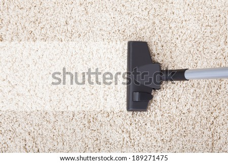 Directly above shot of vacuum cleaner on rug at home - stock photo