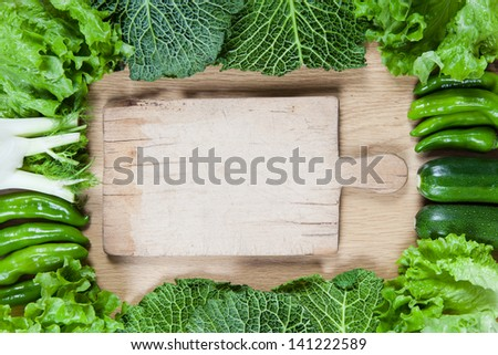 Directly above view of raw vegetables on wooden table  - stock photo