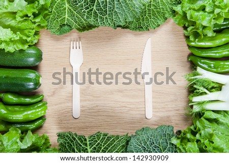 Directly above view of raw vegetables on wooden table