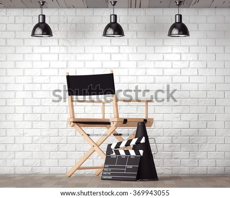 Director Chair, Movie Clapper and Megaphone in front of Brick Wall with Blank Frame extreme closeup - stock photo