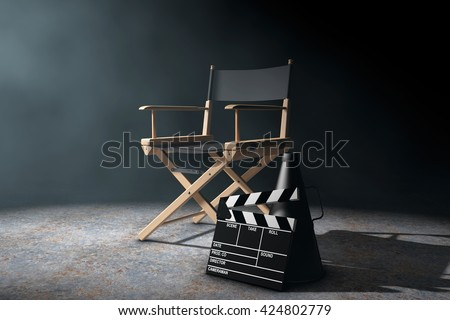 Director Chair, Movie Clapper and Megaphone in the volumetric light on a black background. 3d Rendering - stock photo