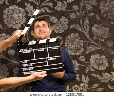 Director Clapping The Clapper Board, Indoor - stock photo