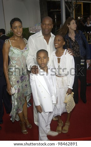 Director JOHN SINGLETON & family at the world premiere of 2 Fast 2 Furious at the Universal Amphitheatre, Hollywood. June 3, 2003