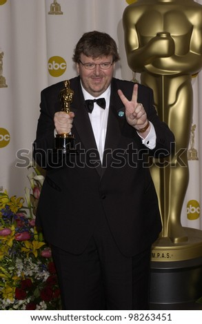 Director MICHAEL MOORE at the 75th Annual Academy Awards at the Kodak Theatre, Hollywood. March 23, 2003 - stock photo