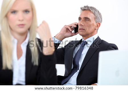 Director receiving phone call on white background - stock photo