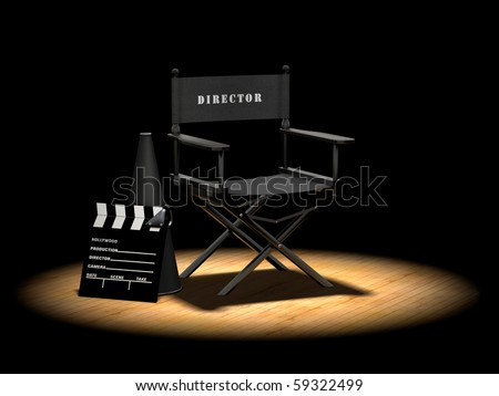 Director's chair with megaphone and clapper board on a wood floor under a spotlight - stock photo