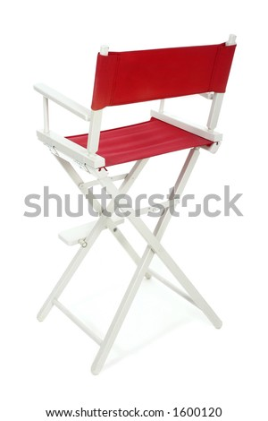 Director's chair with red seat and back on a white frame. Isolated on white background.  Add your text or logo to the back of the chair. - stock photo