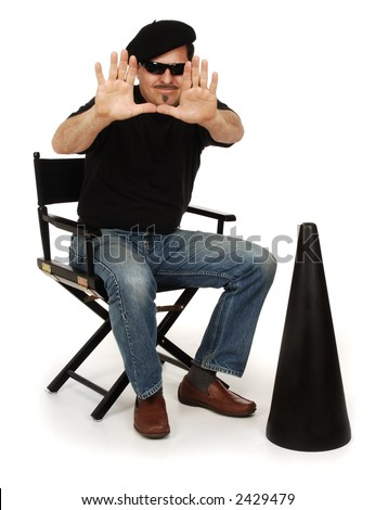 Director wearing berret, and sunglasses sitting in a director's chair with megaphone on white background