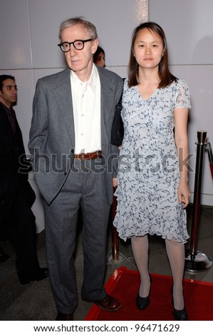 Director WOODY ALLEN & wife SOON-YI at the Los Angeles premiere of his new movie Match Point. December 8, 2005  Los Angeles, CA.  2005 Paul Smith / Featureflash - stock photo