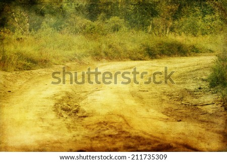 dirt country road in vintage style - stock photo