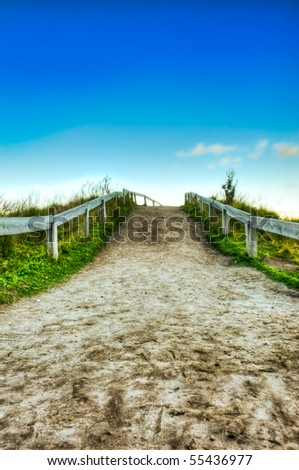 dirt road and clear skies HDR - stock photo