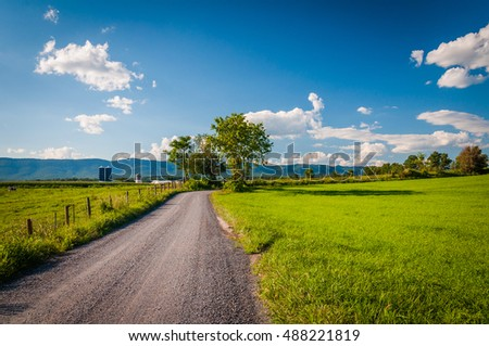 Dirt road and farm fields in the rural Shenandoah Valley of Virginia.