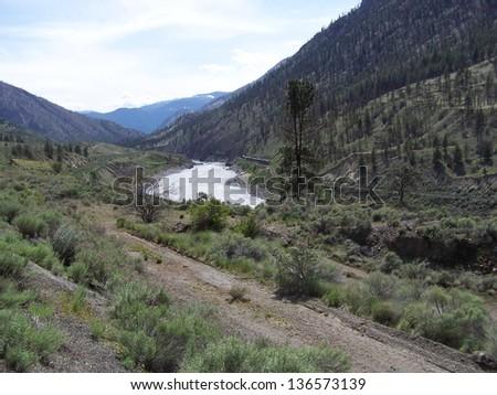Dirt road and railway tracks - stock photo