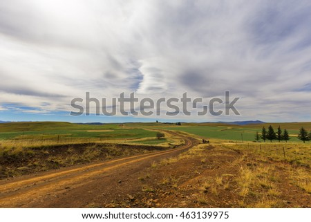 Dirt road and white clouds