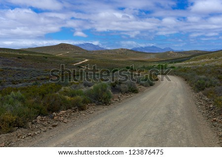 Dirt road at the Sabona Wildlife Reserve in South Africa - stock photo