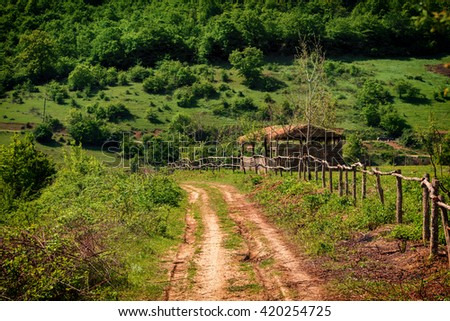 Dirt road in a mountain village.Selective focus - stock photo