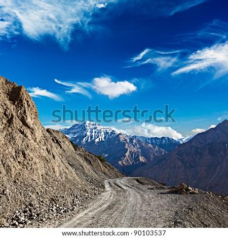Dirt road in mountains (Himalayas). Spiti Valley,  Himachal Pradesh, India - stock photo