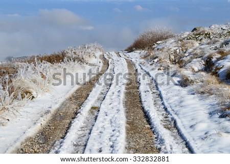 Dirt Road in Snow High in Vitosha Mountain - stock photo