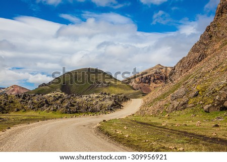 Dirt road in the National Park Lanmannalaugar. Summer trip to Iceland - stock photo