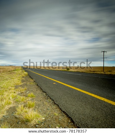 dirt road leading into distance