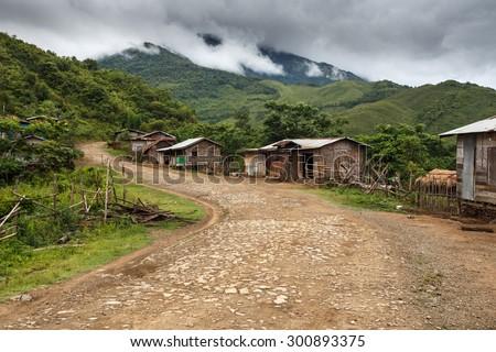 Dirt Road Leading Through Chin State Mountainous Region, Myanmar (Burma) - stock photo
