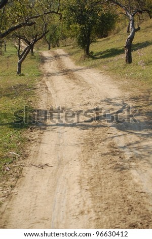 Dirt road on a hill in Romania. - stock photo