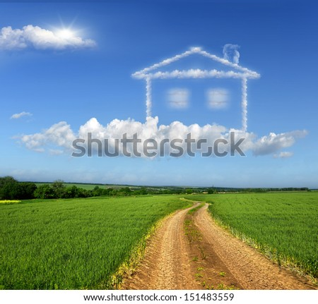 Dirt road through the fields. Symbolizes the realization of the dream of home - stock photo