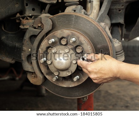 Dirt rusted disc brake on car with caliper - stock photo