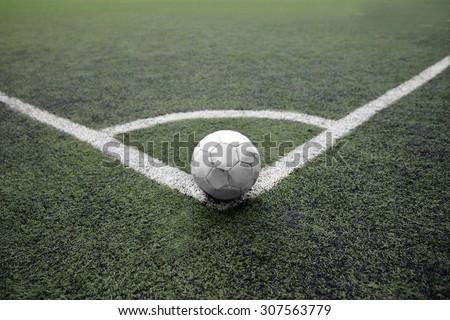 Dirt soccer ball on the football border corner kick position - stock photo