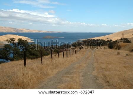 Dirt track along San Luis Reservoir near Los Banos, California - stock photo