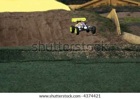 dirt track race with RC toy cars - stock photo