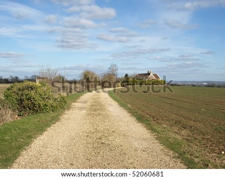 Dirt Track through Agricultural Land - stock photo