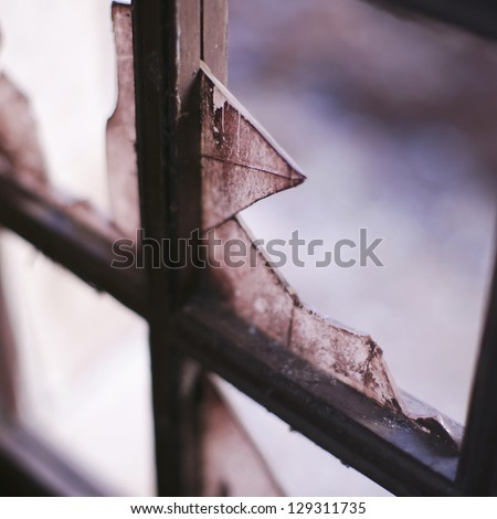Dirty and broken glass, outdoors shoot. Abandoned mine of the Granada city. - stock photo