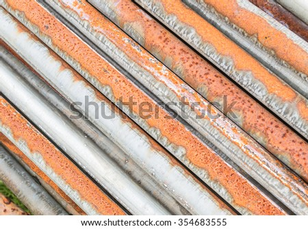 dirty and rusty  old pipes stack background - stock photo