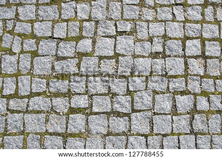 Dirty and unclean urban ground made with cobblestones. - stock photo