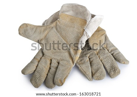 Dirty and well-worn pair of canvas and leather work gloves on white background. - stock photo