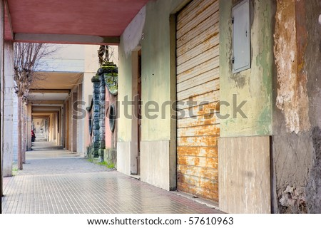 dirty arcade in the old town, old alley in the city - stock photo