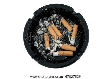 Dirty ashtray full of smoked cigarette butts - stock photo