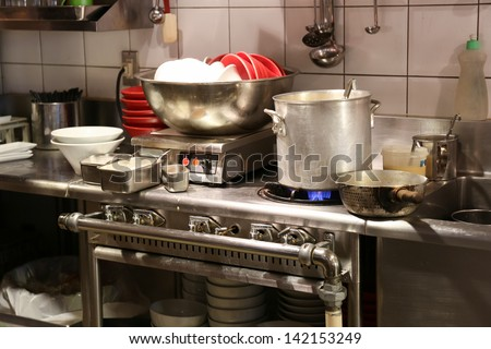 Dirty asian kitchen with unwashed noodle bowls - stock photo