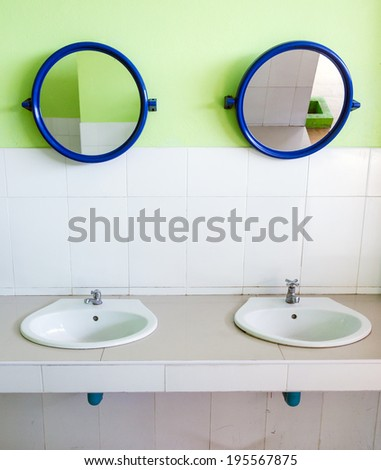 Dirty basin in the public toilet - stock photo