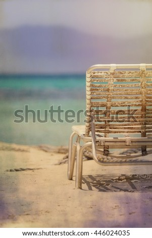Dirty beach chair, ocean background, Dominican republic