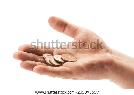 Dirty beggar hand with england coins on white background - stock photo