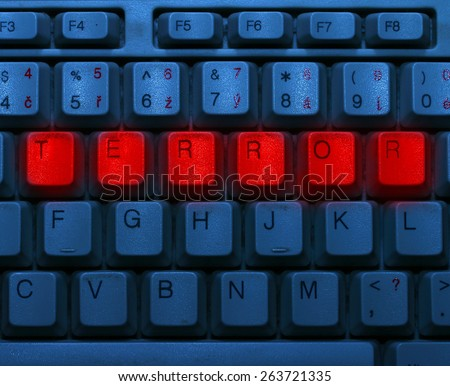 Dirty blue keyboard with red notice Terror. Terrorism online concept. - stock photo
