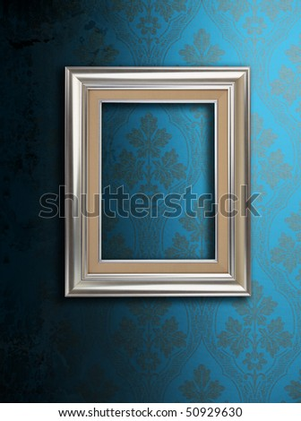 dirty blue wallpaper and an empty frame