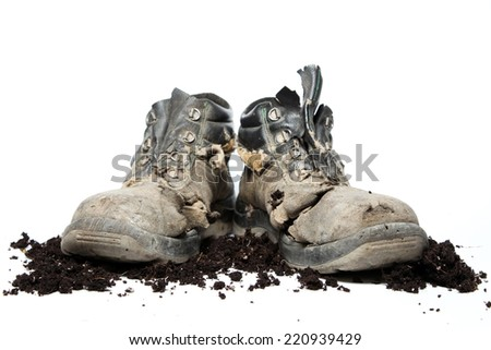 Dirty boots - stock photo