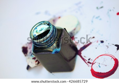 Dirty bottle of ink printer. - stock photo