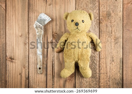 Dirty brush and teddy bear - stock photo