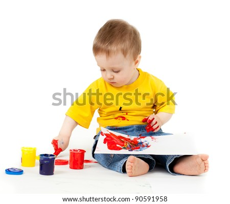 dirty child drawing with a finger's paints - stock photo